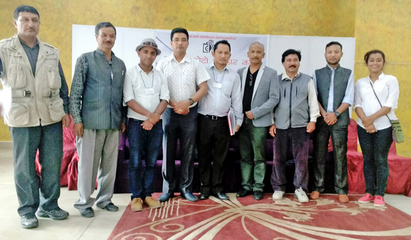 Newly elected officer bearers of the National Forum of Photo Journalists (NFPJ) pose for a group photograph, in Kathmandu, on Monday, September 26, 2016.  Photo: NFPJ