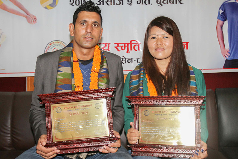 National volleyball players Sanjay Aryal and Manju Gurung pose for a photo after being felicitated by Sanjay Memorial Foundation in Kathmandu on Wednesday, September 21, 2016. Photo: Udipt Singh Chhetry/THT