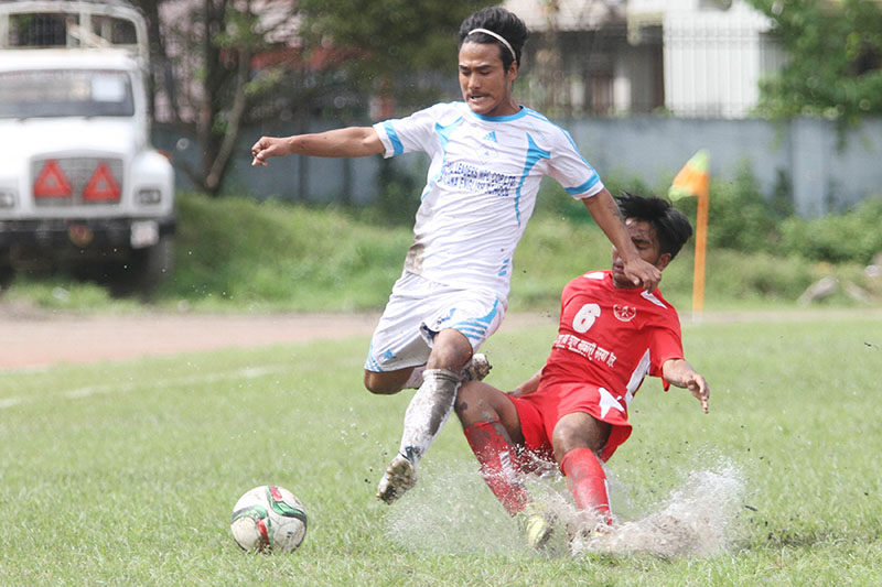 Players of Nayabasti Youth Club and Pulchowk Sports Club (right) vie for the ball during their Martyrs Memorial B Division League match at the Nepal APF Club grounds in Kathmandu on Wednesday, September 21, 2016. Photo: Udipt Singh Chhetry/THT