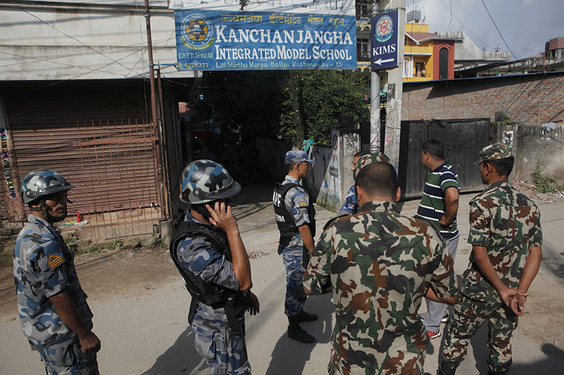 Nepali bomb squad members get ready to dispose a pressure cooker bomb which was kept inside school in Kathmandu, on Tuesday, September 20, 2016. Photo: AP