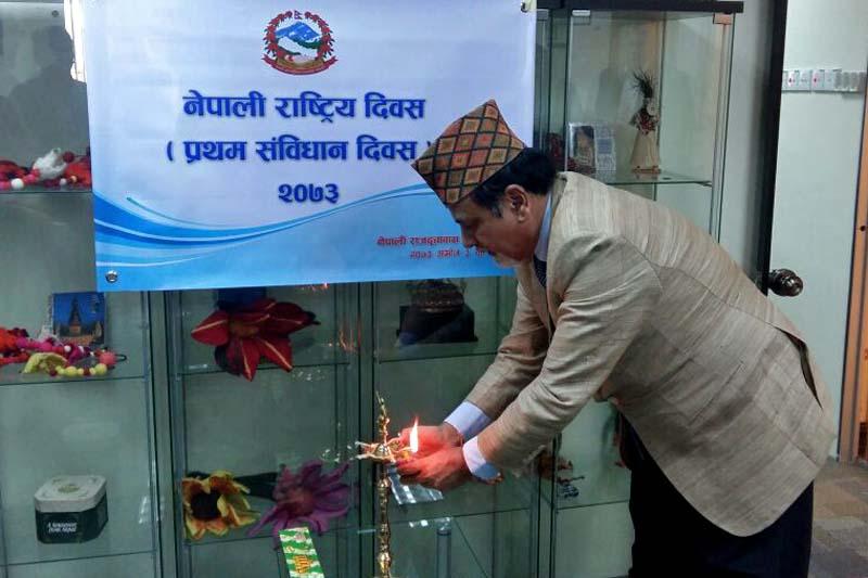 Nepali Ambassador to Malaysia Niranjan Man Singh Basnyat lights a panas to commemorate the Constitution Day, in Kuala Lumpur, on Monday, September 19, 2016. Photo Courtesy: Embassy of Nepal in Kuala Lumpur
