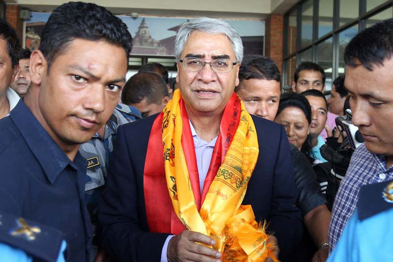 Nepali Congress President Sher Bahadur Deuba being escorted by security personnel and his cadres upon his arrival from Singapore at the Tribhuvan International Airport (TIA), on Saturday, September 3, 2016. Photo: RSS
