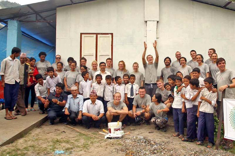 Team members of the Nepali Disaster Volunteers (NDV) after handing over the reconstructed classrooms to Shree Bal Shiksha School, in Khandichaur of Sindhupalchok district, on Friday, September 12, 2016. Photo Courtesy: NDV