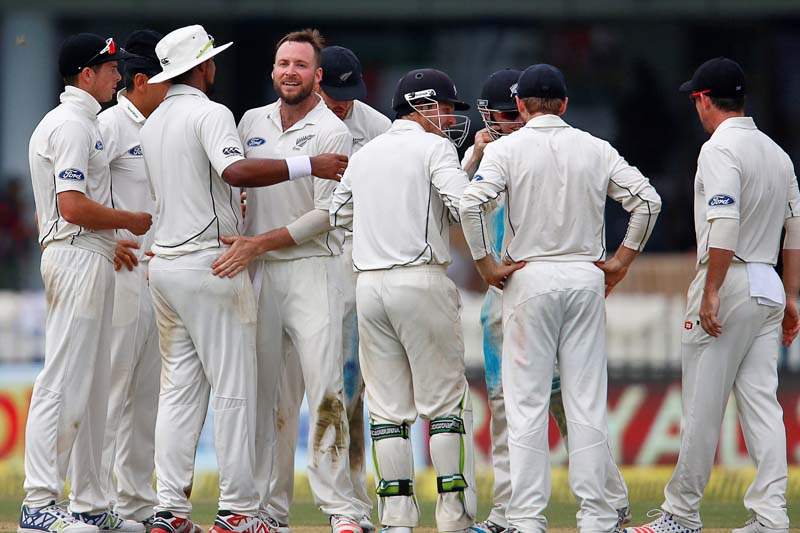 New Zealand's Mark Craig celebrates with teammates after taking the wicket of India's Ajinkya Rahane during their first test cricket match at the Green Park Stadium in Kanpur, India on September 22, 2016. Photo: Reuters