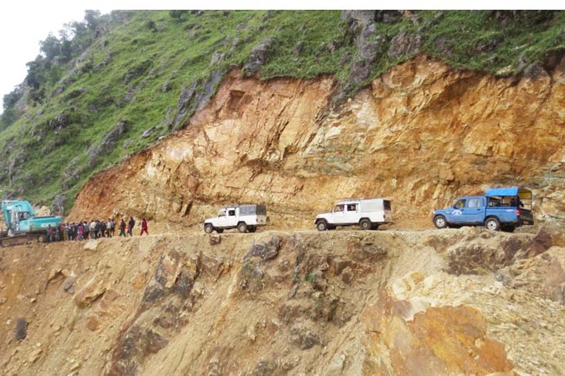 Motors seen plying on the rural road in Mandre, Rayadanda of Baglung. Locals collected Rs 9 million and handed over the project to open the road through a cliff to the Nepal Army. Photo: RSS
