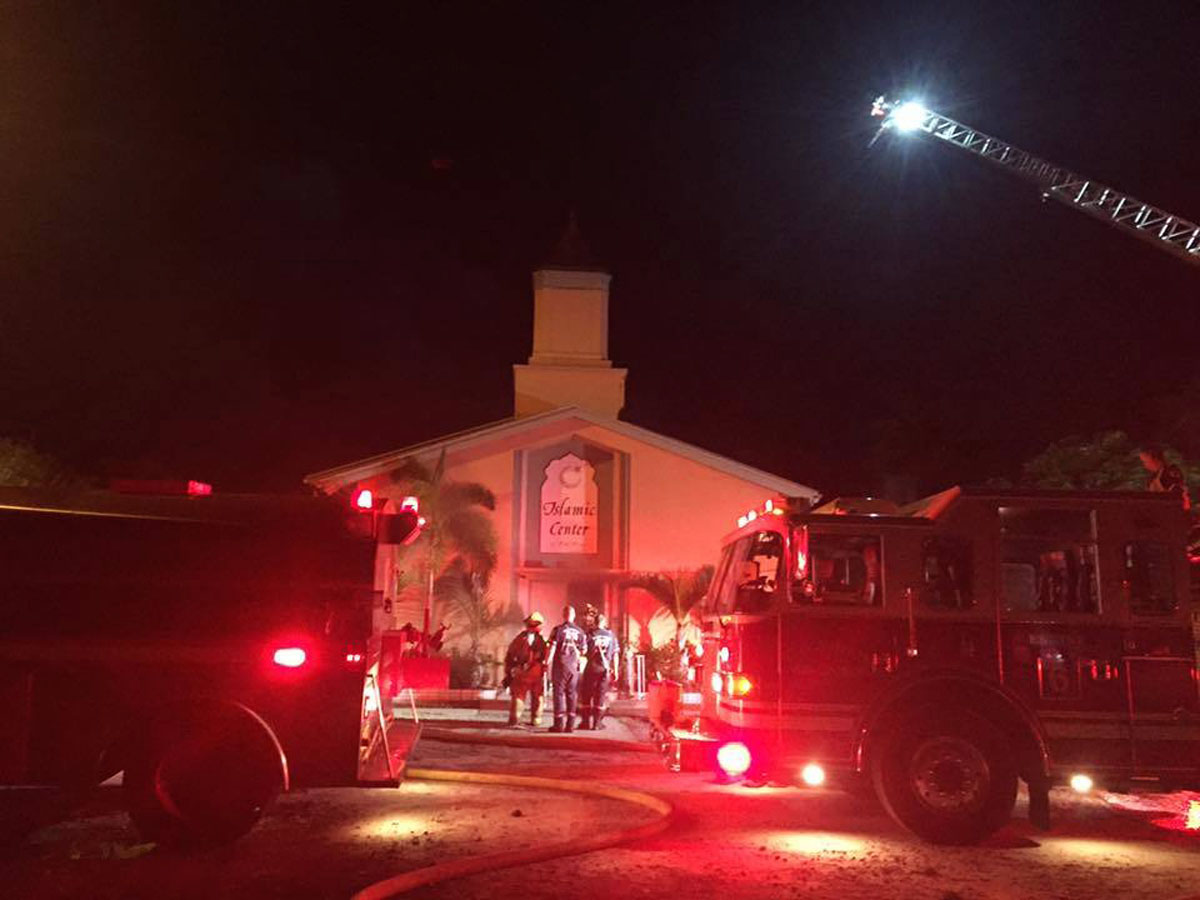 Firefighters work at the scene of a fire at the Islamic Center of Fort Pierce on Monday, September 12, 2016, in Fort Pierce, Florida. Photo: St Lucie Sheriff's Office via AP