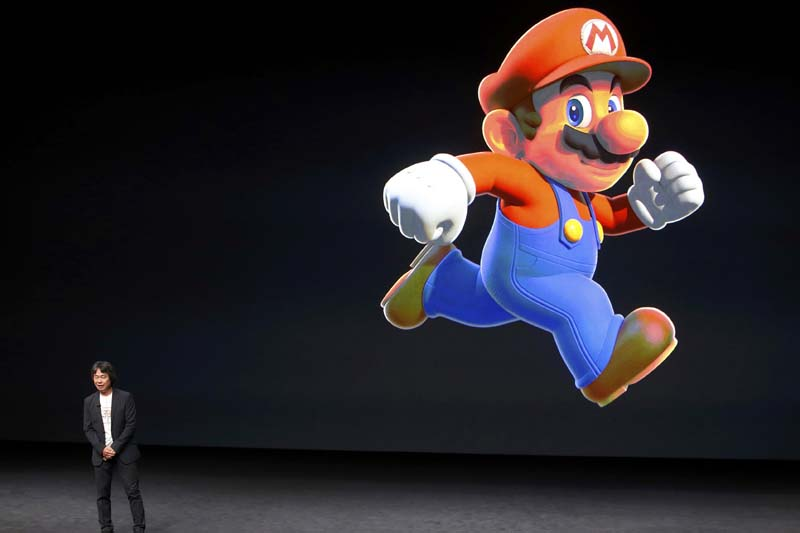 Nintendo Co Creative Fellow Shigeru Miyamoto stands next to the Super Mario character during an Apple media event in San Francisco, California, on September 7, 2016. Photo: Reuters