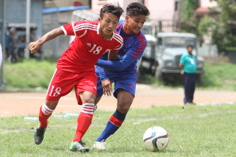 Nirmal Dura of Ranipokhari Corner Team vies for the ball past Kiran Bhujel of Bansbari Club during their Martyrs Memorial B Division League match at the Nepal APF Club grounds in Kathmandu on Wednesday, August 31, 2016. Photo: Udipt Singh Chhetry/THT