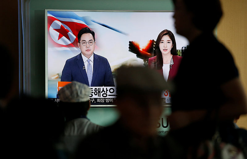Passengers watch a TV screen broadcasting a news report on North Korea firing three ballistic missiles into the sea off its east coast, at a railway station in Seoul, South Korea, on September 5, 2016. Photo: Reuters