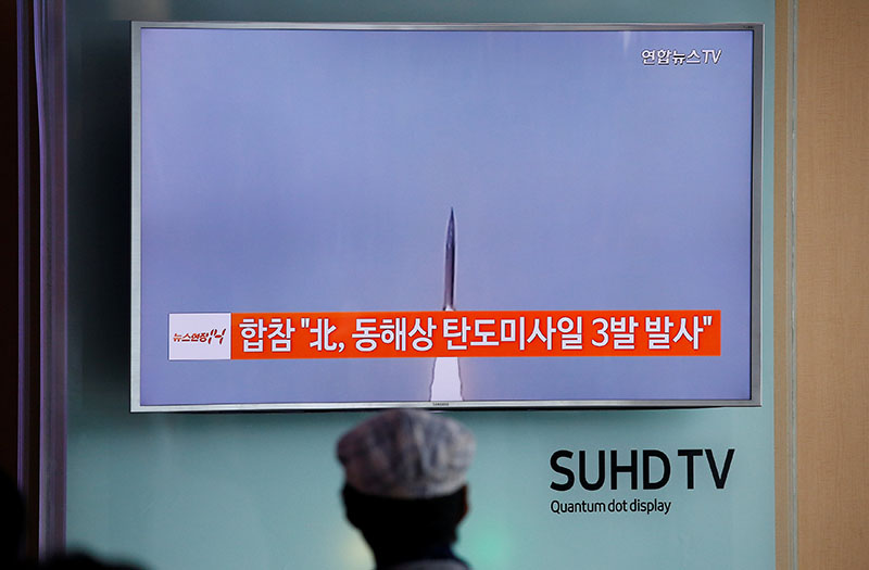 A passenger watches a TV screen broadcasting a news report on North Korea firing three ballistic missiles into the sea off its east coast, at a railway station in Seoul, South Korea, on September 5, 2016. Photo: Reuters