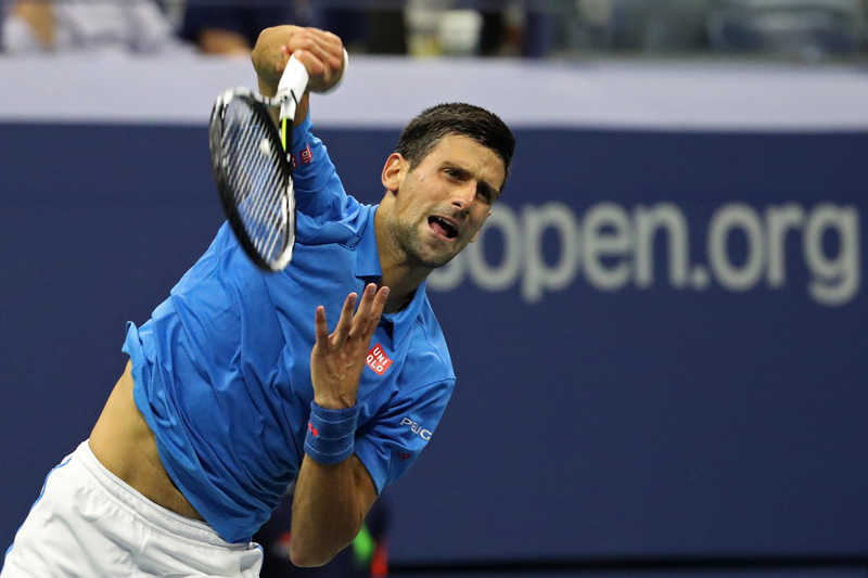 Novak Djokovic of Serbia serves against Kyle Edmund of Great Britain (not pictured) on day seven of the 2016 US Open tennis tournament at USTA Billie Jean King National Tennis Center. Mandatory Credit: Geoff Burke-USA TODAY Sports