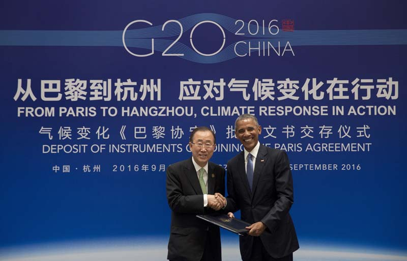 File- US President Barack Obama (R) and United Nations Secretary-General Ban Ki-moon shake hands as the US formally joins the Paris Climate Agreement during a climate event at the Ruyi Hall at Westlake State House in Hangzhou in eastern China's Zhejiang province, on September 3, 2016. Photo: AP