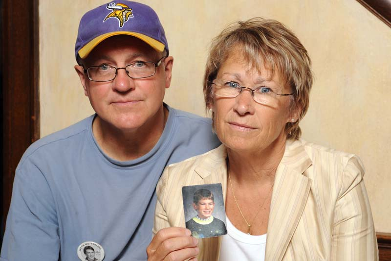Patty and Jerry Wetterling show a photo of their son Jacob Wetterling, who was abducted in October of 1989 in St. Joseph, Minn and is still missing, in Minneapolis,on August 28, 2009. Photo: AP/ File