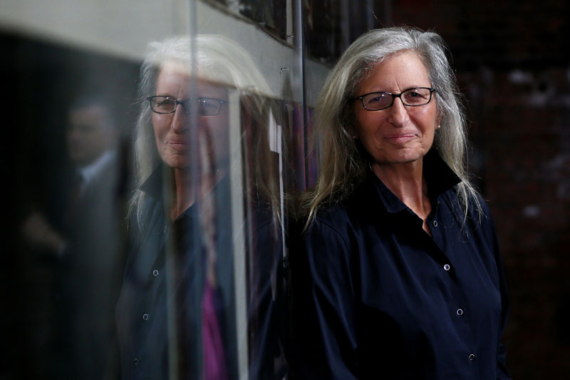 FILE- US photographer Annie Leibovitz is reflected in glass during a press preview of her exhibition 'WOMEN: New Portraits' at Wapping Hydraulic Power Station in London, Britain January 13, 2016. Photo: REUTERS