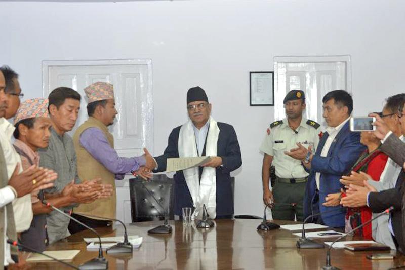 Prime Minister Pushpa Kamal Dahal receives a memorandum from the Nepal Federation of Indigenous Nationalities (NEFIN) President Nagendra Kumar Kumal, in Kathmandu, on Sunday, September 11, 2016. Photo: PM's Secretariat