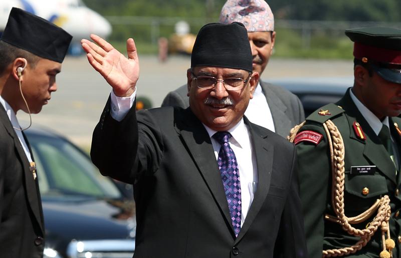 Prime Minister Pushpa Kamal Dahal waves before he leaves for New Delhi of India on Thursday, September 15, 2016. Photo: RSS