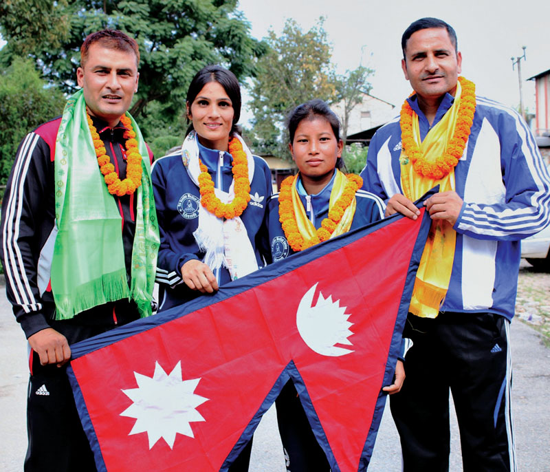 (From left) Coach Kalyan Kunwar, players Sita Bhandari, Ranjana Dhami and team leader Deepak Bista pose for a group photo during a farewell programme in Kathmandu on Tuesday, September 13, 2016. Photo- THT