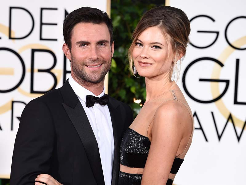 File- Adam Levine (L) and Behati Prinsloo arrive at the 72nd annual Golden Globe Awards in Beverly Hills, California, on January 11, 2015. Photo: AP