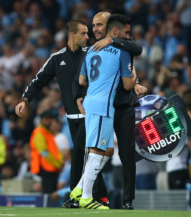 Manchester City's manager Pep Guardiola (centre) hugs his player Manchester City's Ilkay Gundogan as he is substituted during the Champions League group C soccer match at the Etihad Stadium between Manchester City and Borussia Moenchengladbach in Manchester, England, on Wednesday, September 14, 2016. The match was rearranged from Tuesday due to adverse weather conditions in Manchester.  Photo: AP