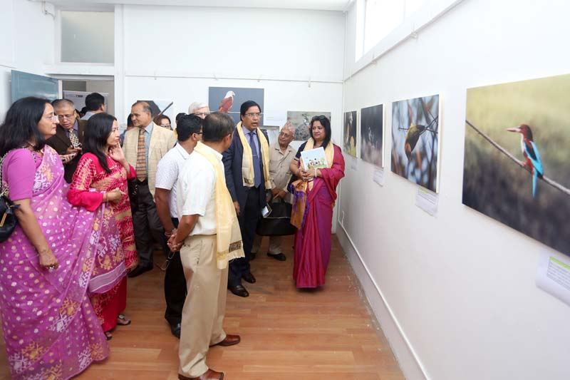 Dignitaries observe photos of birds exhibited at the Nepal Art Council, in Kathmandu, on Friday, September 2, 2016. Photo: RSS