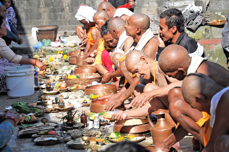 Hindus offer pinda, a food offering, to their deceased ancestors as the fortnight devoted to the ancestors, called Pitri Paksha, ends, in Hanumanghat of Bhaktapur district, on Friday, September 30, 2016. Photo: RSS