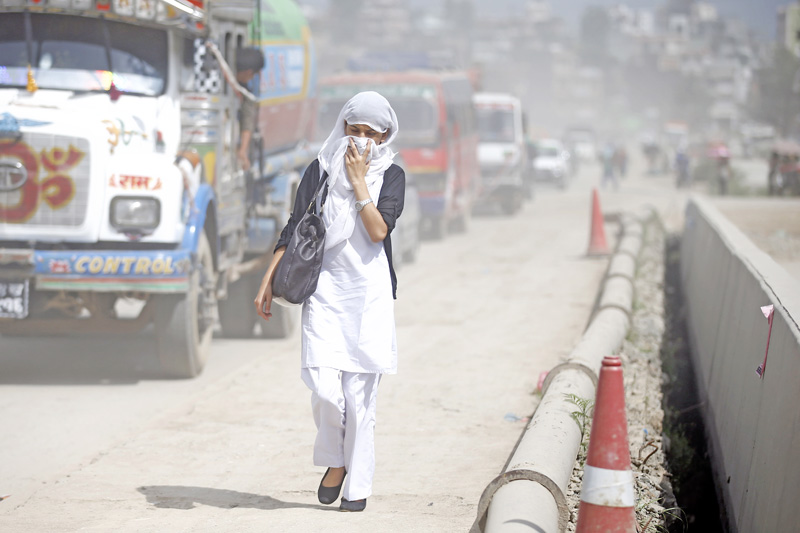 A woman covers her face to shield polluted air in Balkhu, Kathmandu on Thursday, September 22, 2016. Nepal ranks 177 among 180 countries in terms of air quality with pollution index of 81.76. Photo: Skanda Gautam