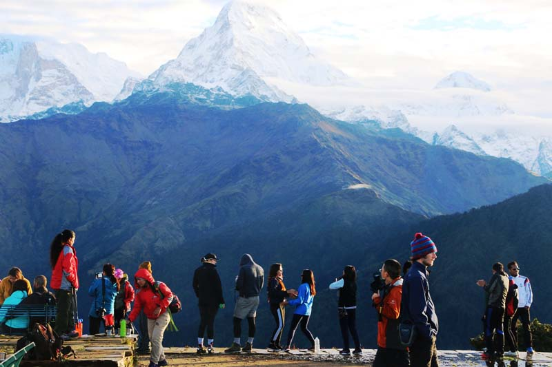 Tourists are seen enjoying view of a mountain range at the sunrise in Poon Hill, Ghara-1 of Myagdi district, on Tuesday, September 27, 2016. Photo: RSS