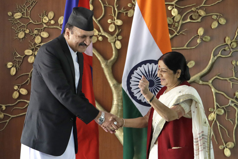 FILE: Minister for Foreign Affairs Prakash Sharan Mahat (left) shakes hands with Indian counterpart Sushma Swaraj, in New Delhi, India, on Monday, September 12, 2016. Mahat is on a three-day visit to India. Photo: AP