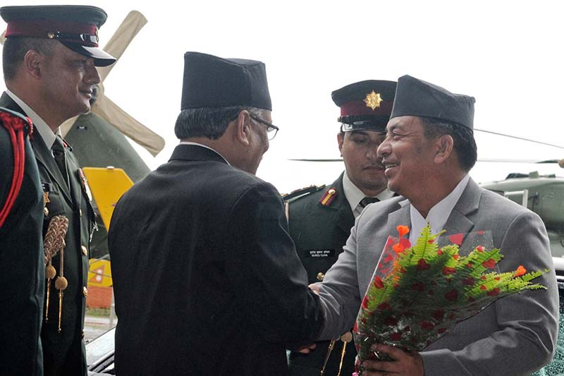 Prime Minister Pushpa Kamal Dahal receives Vice-President Nanda Bahadur Pun upon the latter's return from Venezuela after attending the 17th Non-Aligned Movement (NAM) Summit, at the Tribhuvan International Airport, in Kathmandu, on Wednesday, September 21, 2016. Photo: RSS