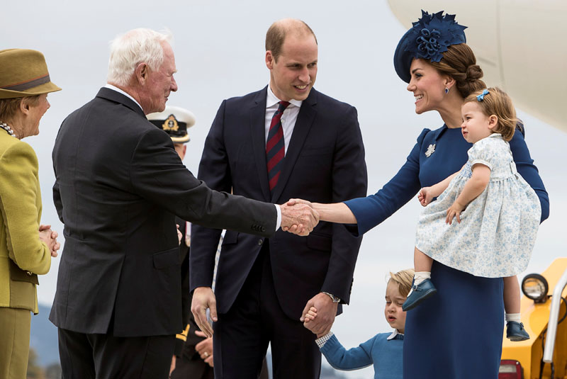 Britain's Prince William, Catherine, Duchess of Cambridge, Prince George and Princess Charlotte are greeted by David Johnston the Governor General of Canada at the Victoria International Airport for the start of their eight day royal tour to Canada in Victoria, British Columbia, Canada, on September 24, 2016. Photo: Reuters