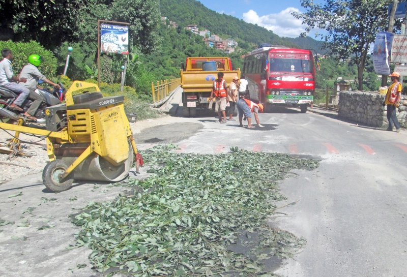 The Muglin-Kotre road section on Prithivi Highway being repaired in Byas Municipality, Tanahun, on Thursday, September 29, 2016. Photo: THT