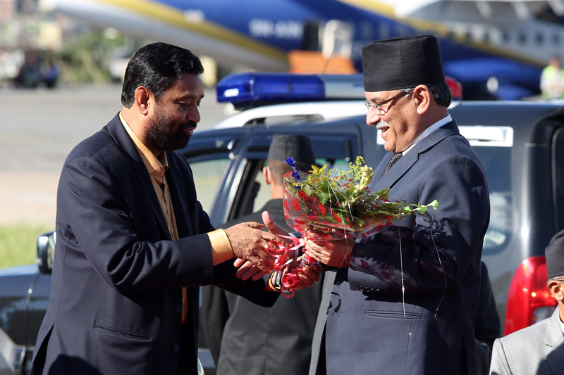 Deputy Prime Minister Bimalendra Nidhi welcomes Prime Minister Pushpa Kamal Dahal as the latter arrives at the Tribhuvan International Airport, after concluding his state visit to India, on Sunday, September 18, 2016. Photo: RSS