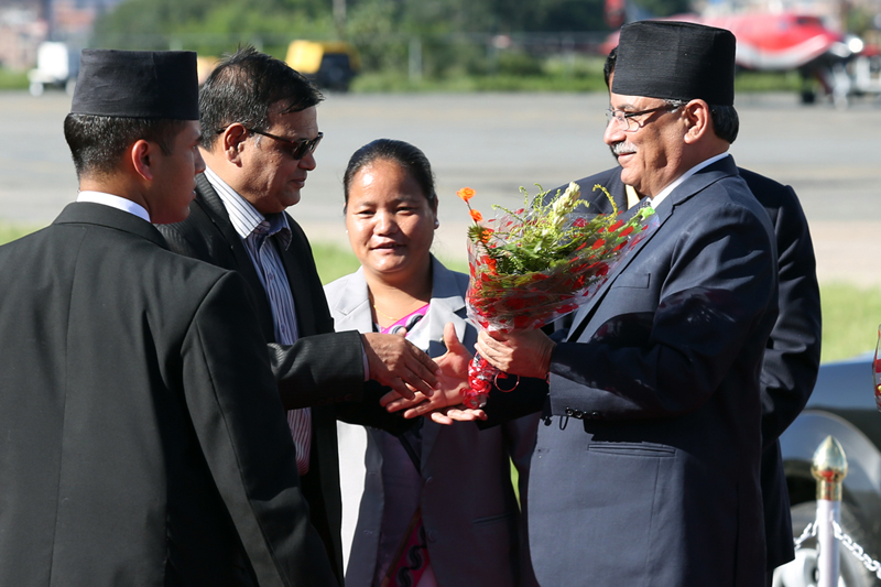 Deputy Prime Minister Krishna Bahadur Mahara welcomes Prime Minister Pushpa Kamal Dahal as the latter arrives at the Tribhuvan International Airport, after concluding his state visit to India, on Sunday, September 18, 2016. Photo: RSS