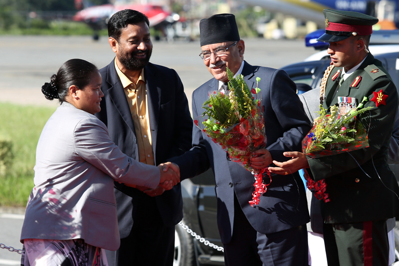 Speaker Onsari Gharti Magar welcomes Prime Minister Pushpa Kamal Dahal as the latter arrives at the Tribhuvan International Airport, after concluding his state visit to India, on Sunday, September 18, 2016. Photo: RSS