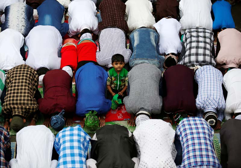 A boy looks on as Nepali Muslims attend the mass prayer during the Eid al-Adha celebrations at the Kashmiri Takiya Jame mosque in Kathmandu, on Tuesday, September 13, 2016. Photo: Reuters