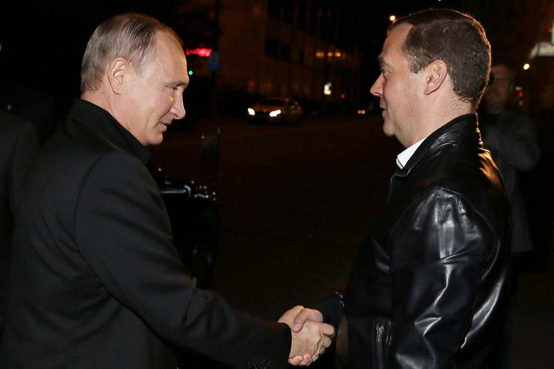 Russian President Vladimir Putin greets Prime Minister and Chairman of the United Russia party Dmitry Medvedev during a visit to the party's campaign headquarters following a parliamentary election in Moscow, Russia, on Sunday, September 18, 2016. Photo: Reuters