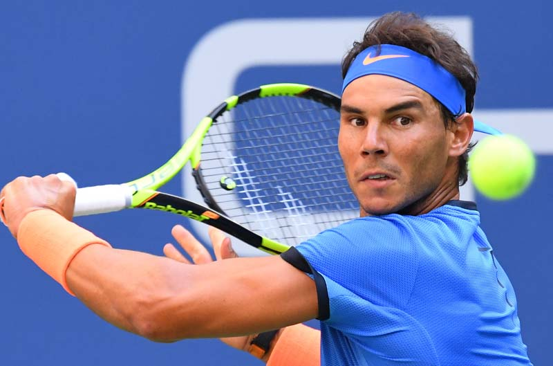 Rafael Nadal of Spain hits to Lucas Pouille of France (not pictured) on day seven of the 2016 US Open tennis tournament at USTA Billie Jean King National Tennis Centre in New York, on September 4, 2016. Photo Courtesy: USA Today Sports via Reuters