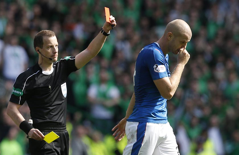 Rangers' Philippe Senderos is shown a second yellow card and sent off by William Collum.