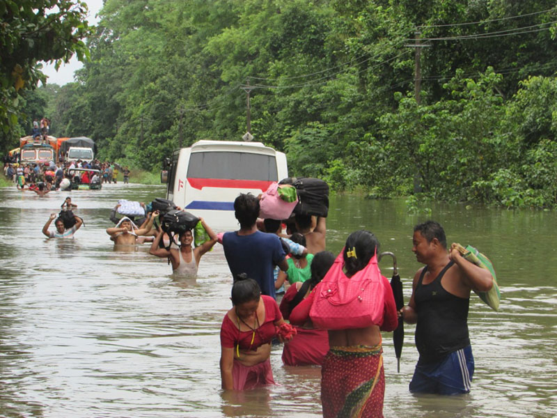 Commuters cross the flooded causeway following heavy rainfall at Paurahi jungle of Bagmati River along the Bagmati-Paurahi road section in Rautahat district, on Monday, September 12. Photo: THT