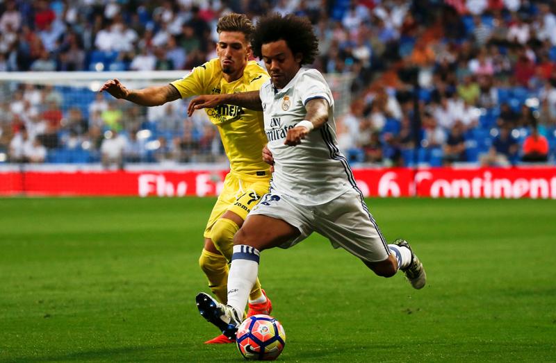 Real Madrid's Marcelo and Villarreal's Samuel Castillejo in action during La Liga game at the Santiago Bernabeu, in Madrid, on Wednesday, September 21, 2016. Photo: Reuters