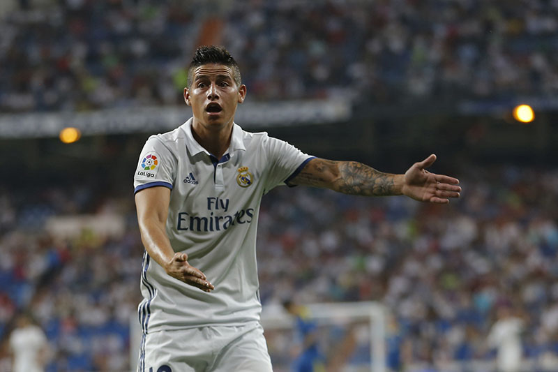 Real Madrid's James Rodriguez gestures to an assistant referee during the Spanish La Liga soccer match between Real Madrid and Celta Vigo at the Santiago Bernabeu stadium in Madrid, on Saturday, August 27, 2016. Real Madrid won 2-1. Photo: AP
