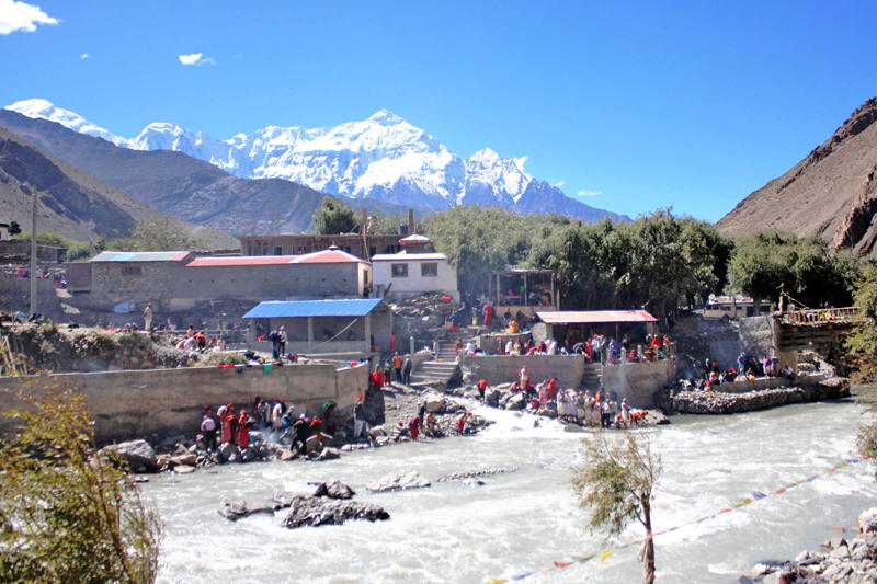 Hindus offer pinda, a food offering, to their deceased ancestors as the fortnight devoted to the ancestors, called Pitri Paksha, ends, on the bank of Kaligandaki river in Kagbeni of Mustang district, on Friday, September 30, 2016.