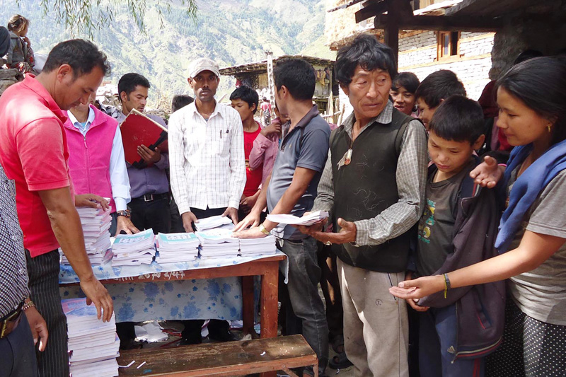 Books being distributed to rural students in Gamgadhi, district headquarters of Mugu, on Wednesday, September 28, 2016. Photo: RSS