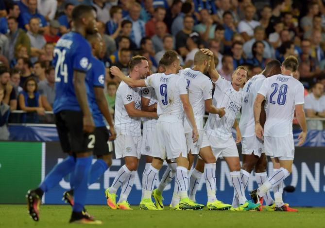 Soccer Football - Club Brugge v Leicester City - UEFA Champions League Group Stage - Group G - Jan Breydel Stadium, Brugge, Belgium - 14/9/16nLeicester City's Riyad Mahrez (hidden) celebrates with team mates after scoring their second goal nReuters / Eric Vidal