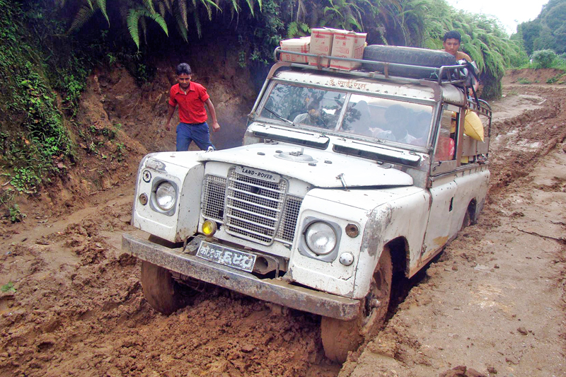 A jeep is seen stuck in a muddy rural road in Ilam district, on Friday, September 30, 2016. Photo: RSS