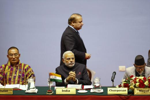 Bhutan's Prime Minister Tshering Tobgay (L), India's Prime Minister Narendra Modi (C), Pakistan's Prime Minister Nawaz Sharif (C, standing) and Nepal's Prime Minister Sushil Koirala attend the opening session of 18th South Asian Association for Regional Cooperation (SAARC) summit in Kathmandu November 26, 2014. REUTERS/Narendra Shrestha/Pool