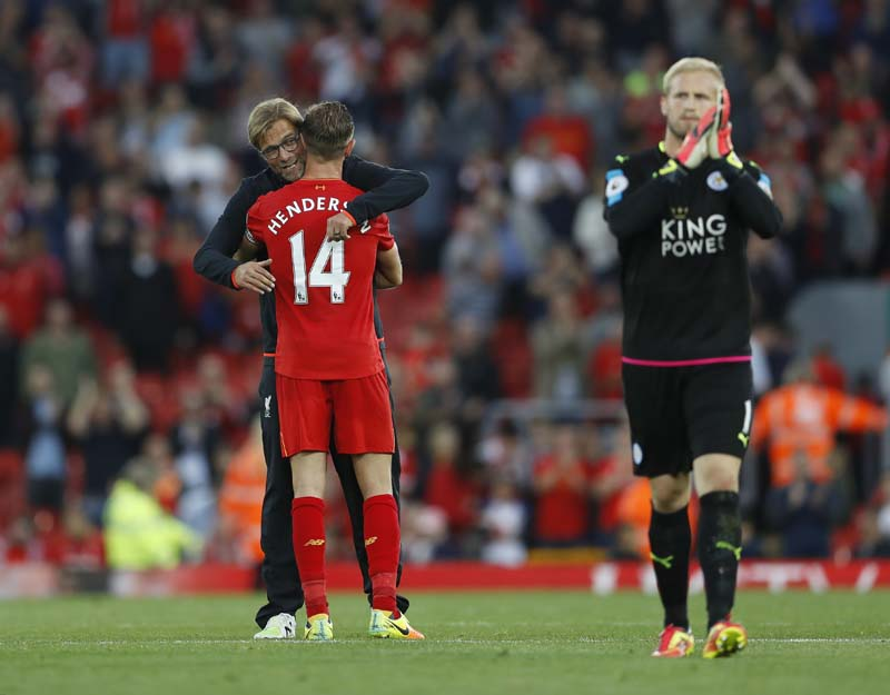 File- Liverpool manager Juergen Klopp with Liverpool's Jordan Henderson as Leicester City's Kasper Schmeichel applauds fans after the game, in Anfield on September 10, 2016. Photo: Reuters