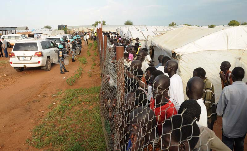 File- UN peacekeepers stand guard outside the fence at a demonstration by people displaced in the recent fighting, during a visit by the United Nations Security Council, delegation to the UN House in Jebel, near South Sudan's capital Juba, on September 3, 2016. Photo: Reuters
