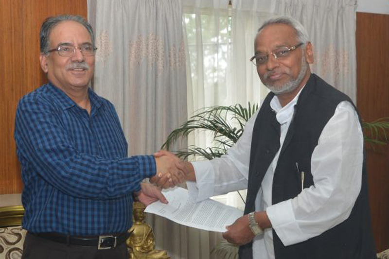 Sadbhawana Party Chairman Rajendra Mahato (left) hands over a memorandum to Prime Minister Pushpa Kamal Dahal, in Kathmandu, on Friday, September 9, 2016. Photo: PM's Secretariat