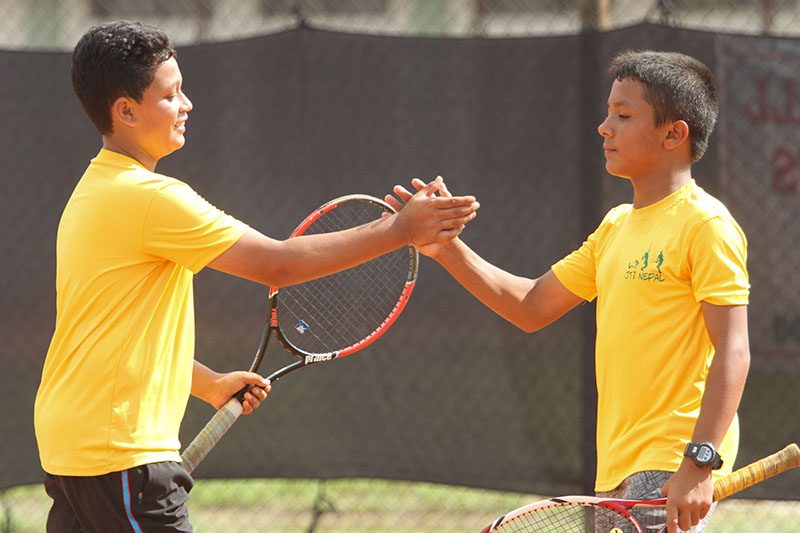 Saharsha Chand (left) celebrates with teammate Aadit Subedi after defeating Indian pair of Sashikant Thakur and Shrikant Thakur in boysu2019 doubles semi-final match of the Kesha Group ANLTA-Asian Junior Tour U-14 Circuit-II Tournament in Lalitpur on Wednesday, September 14, 2016. Photo: Udipt Singh Chhetry / THT